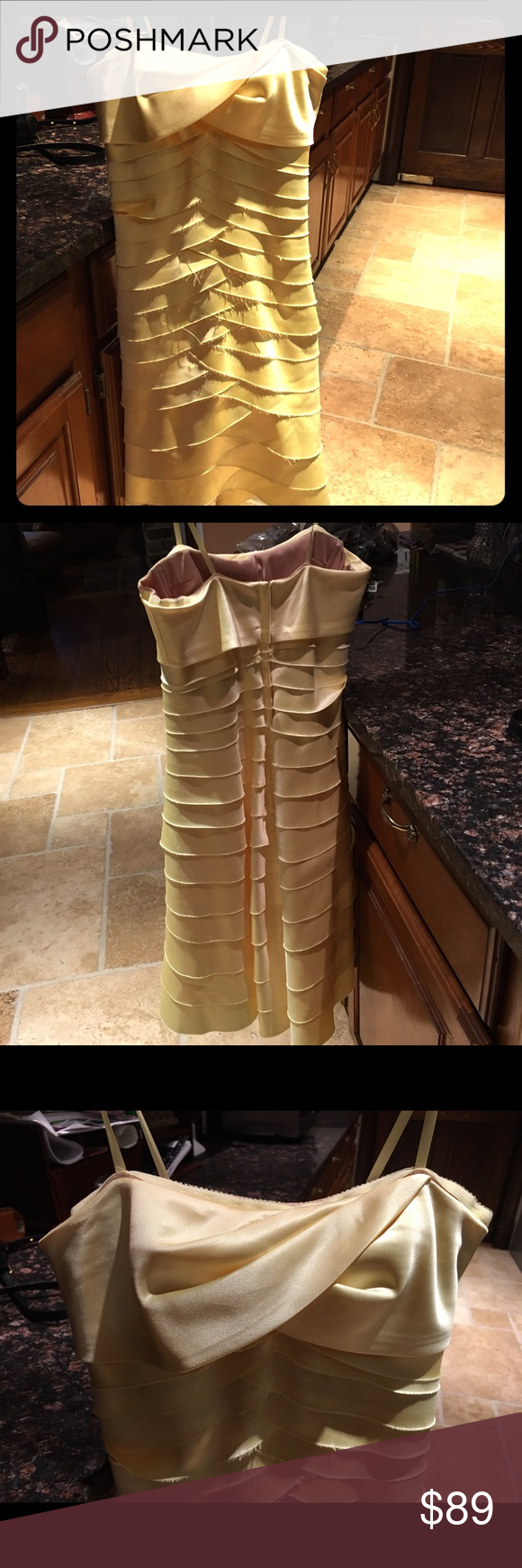 BCBG Max Azria yellow gold strapless dress xs 0/2 BCBG Max Azria yellow gold tiered strapless dress, taken in to fit a size xs 0/2! Beautiful, never worn and in perfect condition! Questions and offers welcome. NWOT BCBGMaxAzria Dresses Strapless