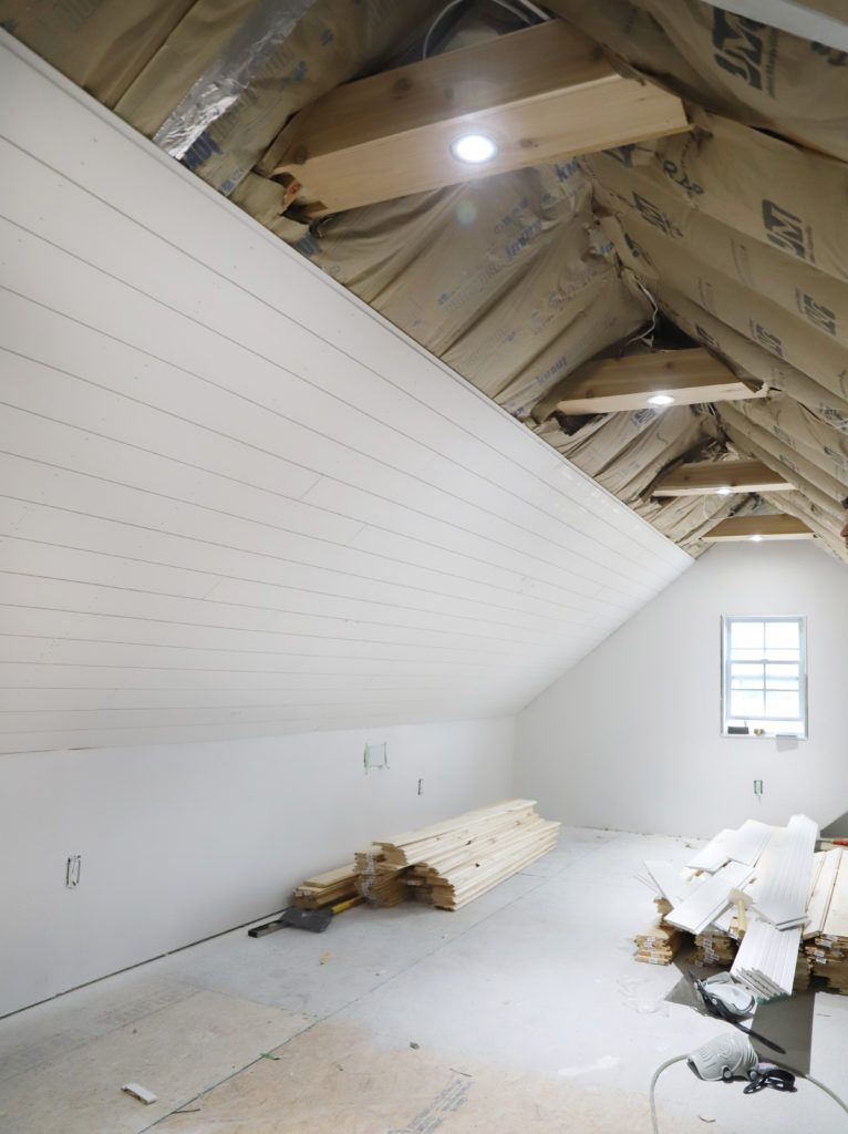 Photo of White Shiplap Ceiling & Cedar Beams