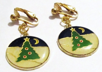 """These are a new pair of 1 1/2"""" Round Gold Plated Christmas Tree Night Scene Dangle Handcrafted Clip-on Earrings, comfortable, lead free - spring clip-on's. They will never tarnish. They are very well made and sturdy fitting lightly to your ears. The clips are silver plated. The best way to clean these earrings are with jewelry cleaning and a polishing cloth.    If the buyer prefers, we will make these into pierced earrings. Just email us to let us know.    Please review the picture."""