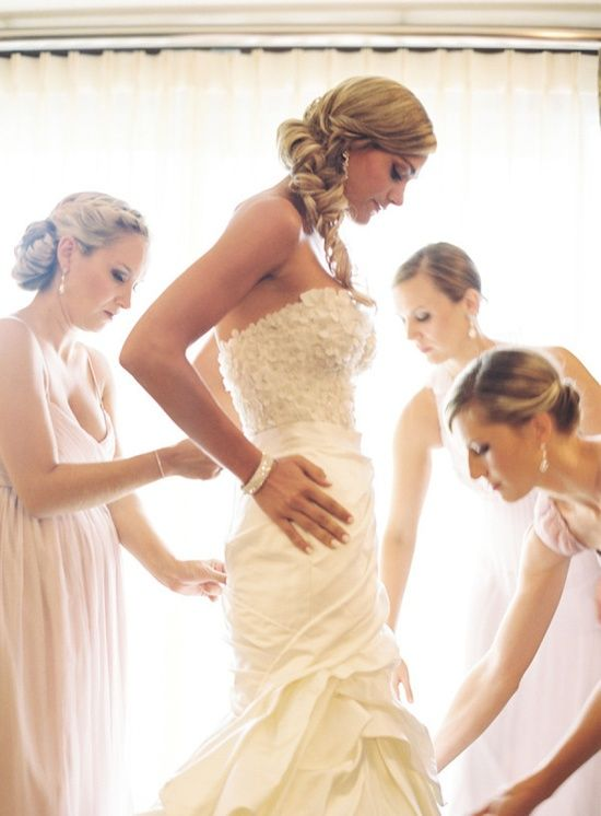 Have a pic with your bridesmaids helping you get ready