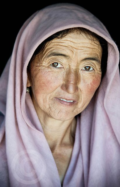 A portrait of an old lady near Jirghitol, in the north east of Tajikistan... by Gabriel Olivier