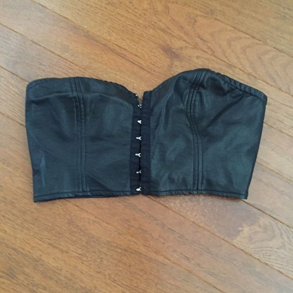 Urban Outfitters leather bustier Front closure. Cropped strapless style. Faux leather. Great for Halloween cat costume! Fits 32-34 a/b bust. Urban Outfitters Intimates & Sleepwear Bandeaus