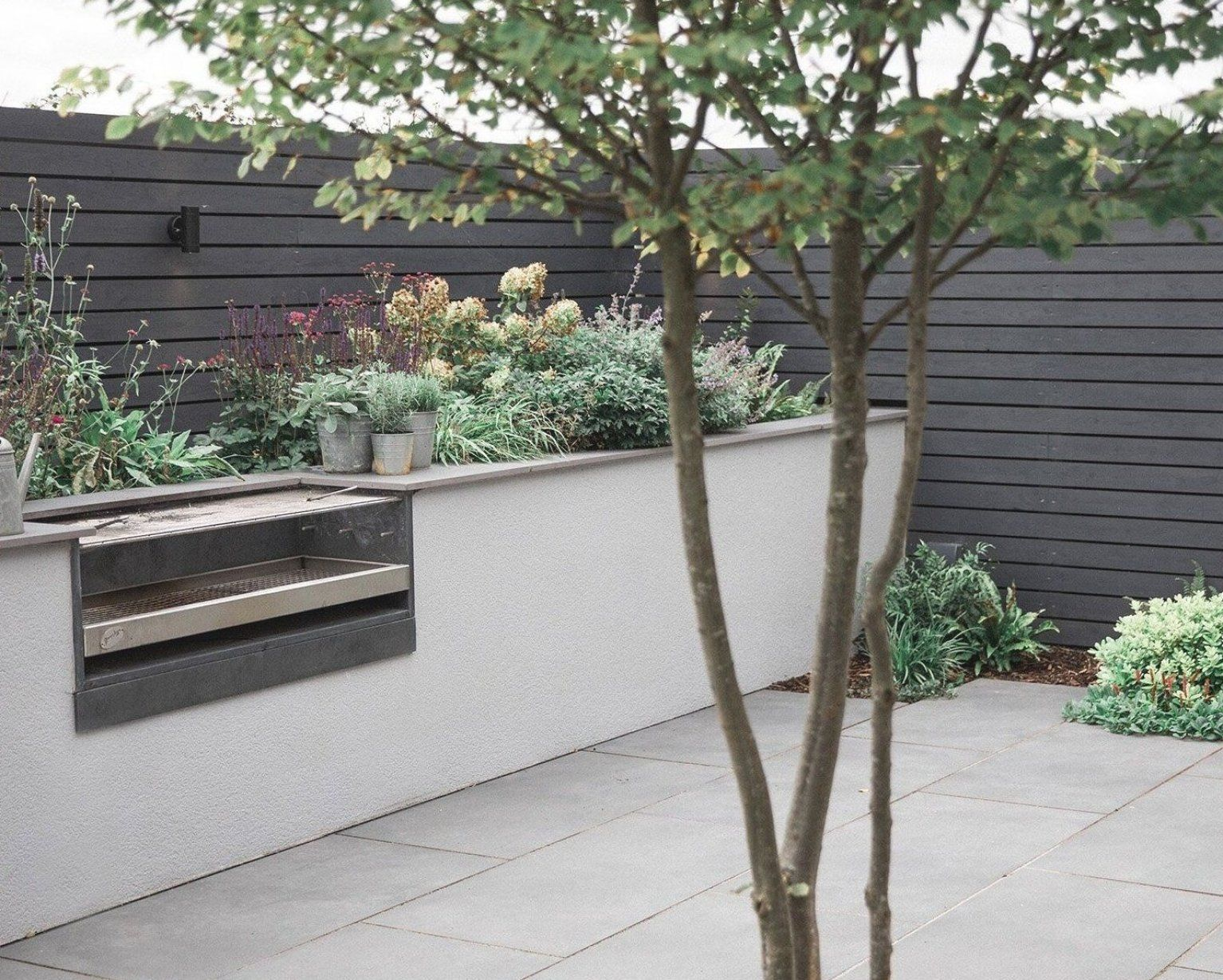 This Modern Family Garden In The Vale Of Glamorgan Features A Cosy Seating Area Built In Charcoal Barbecue And Co In 2020 Family Garden Fragrant Garden Fragrant Plant