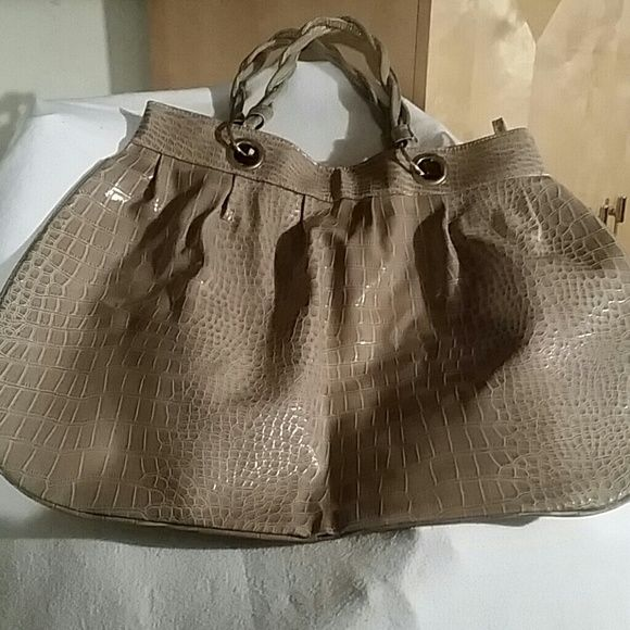 Bag Tan patent leather crocodile print bag, double twisted straps, one zip section on the inside. This bag is practically new, carried once. No rips! Pic #4 shows a small spot of discoloration (from being packed up), not that noticeable that takes away from the bag. Jessica Simpson Bags