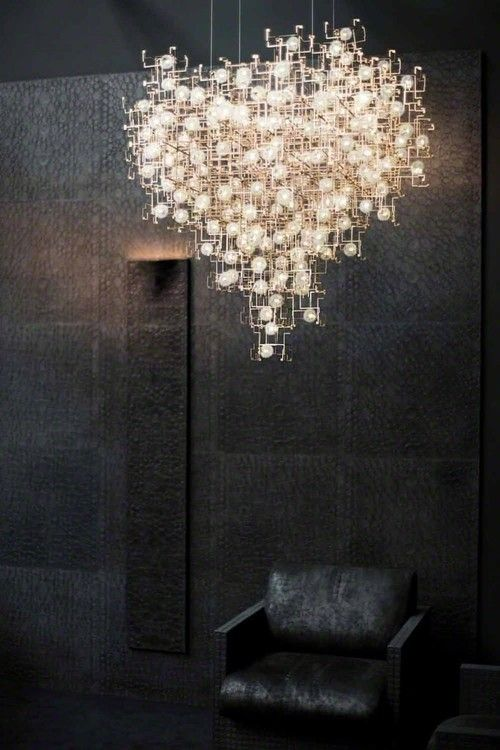 sculptural chandeliers accented with real dandelion seeds