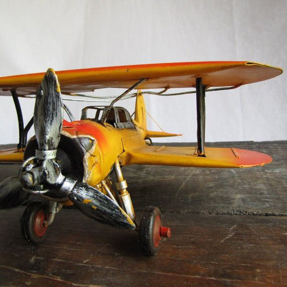 I can't be the only person who wants to decorate her office with a few vintage airplanes, right? #office #vintage #plane
