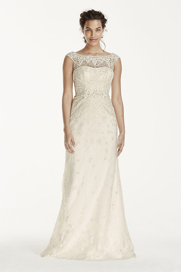 Adorned With Lace Appliques This Vintage Inspired Cap Sleeve Sheath Gown Is A Bohemian