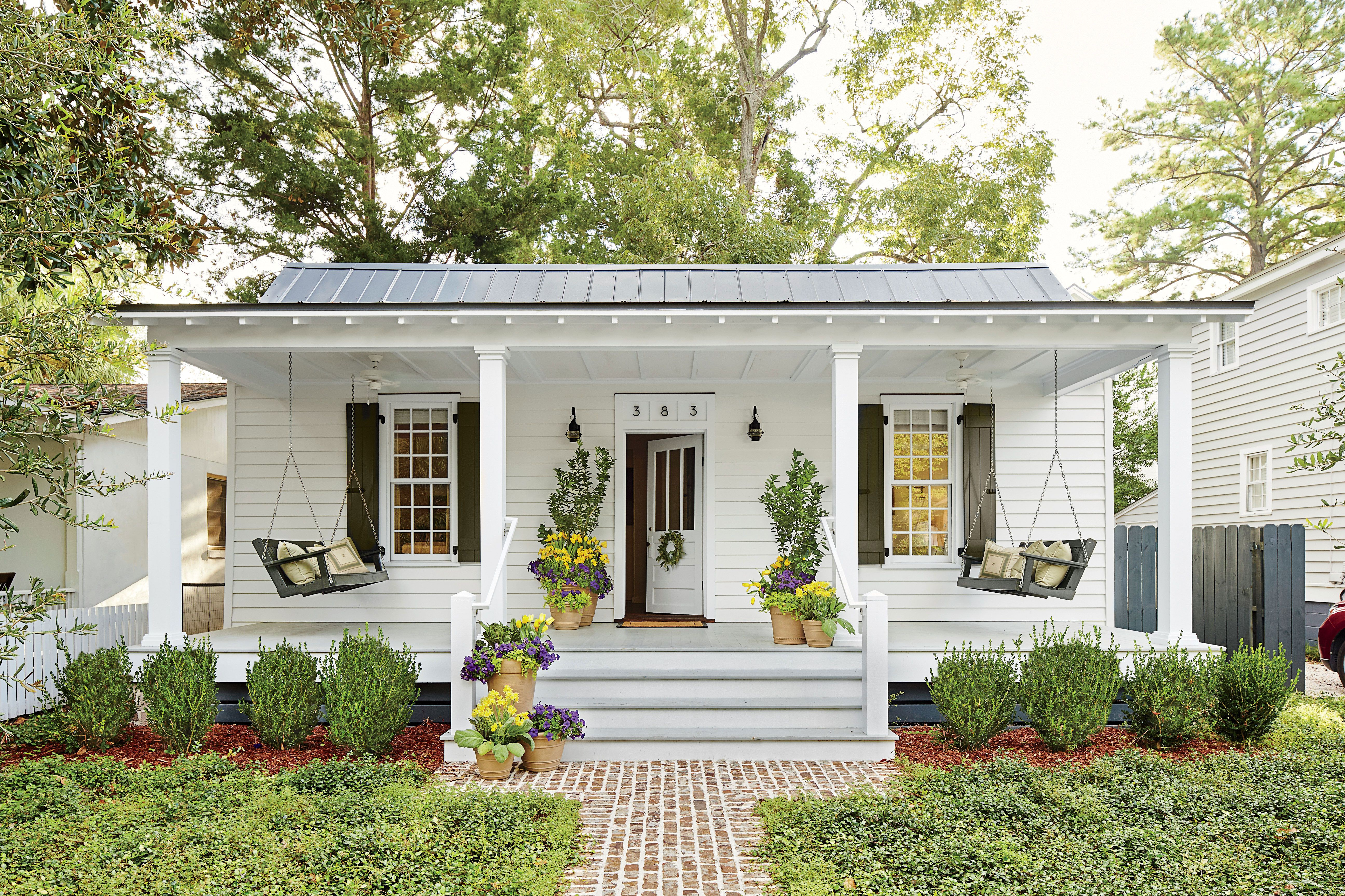 White porch with two swings front porch in house home cottage