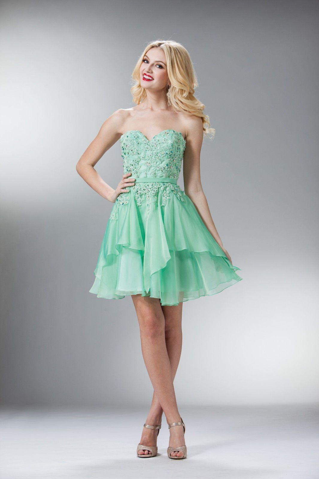 This cute little number has a short layered skirt with a beaded and