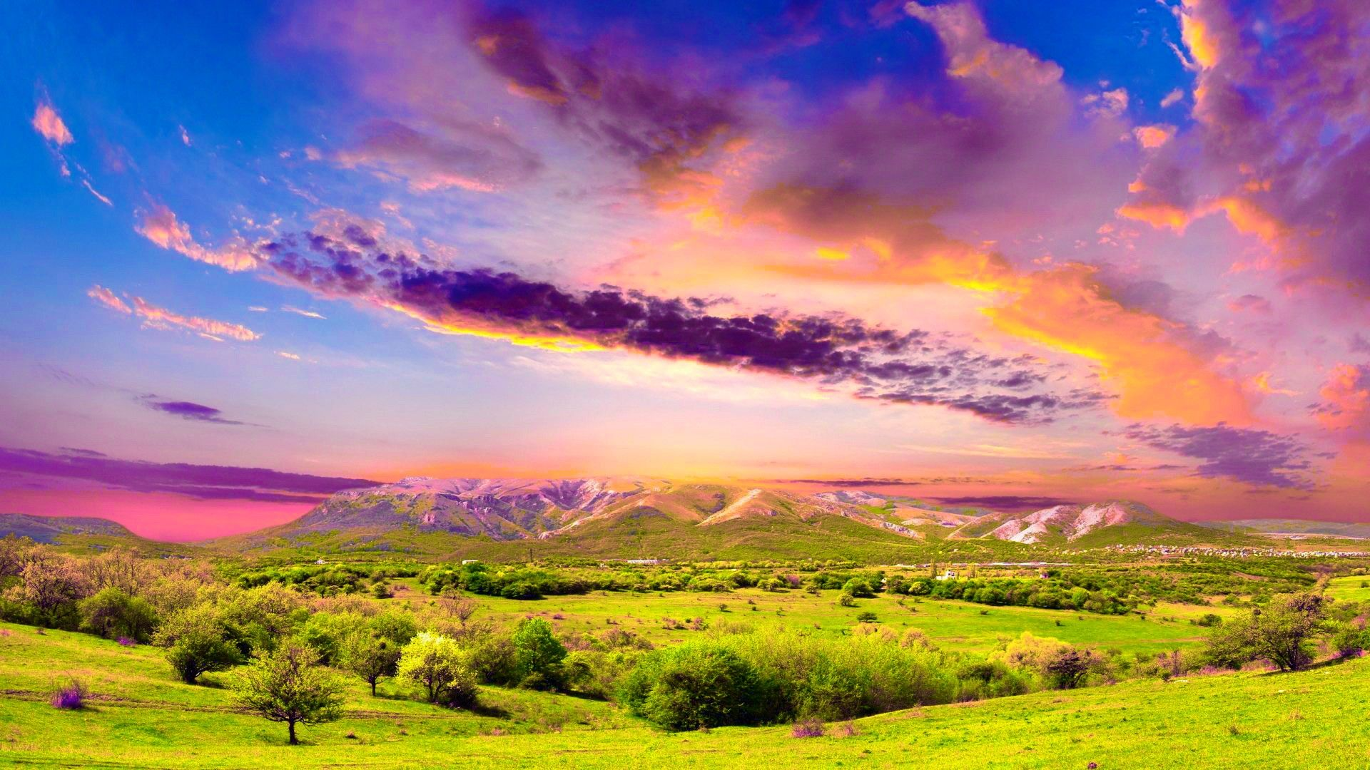 The green fields and pink skies