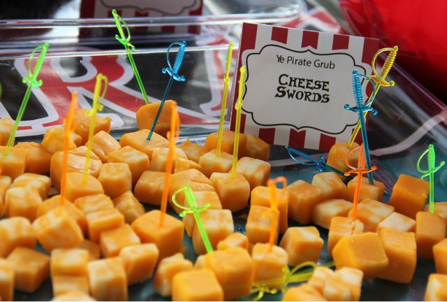 Cheese cubes with tiny swords at a Pirate Party.  See more party ideas at CatchMyParty.com. #piratepartyideas