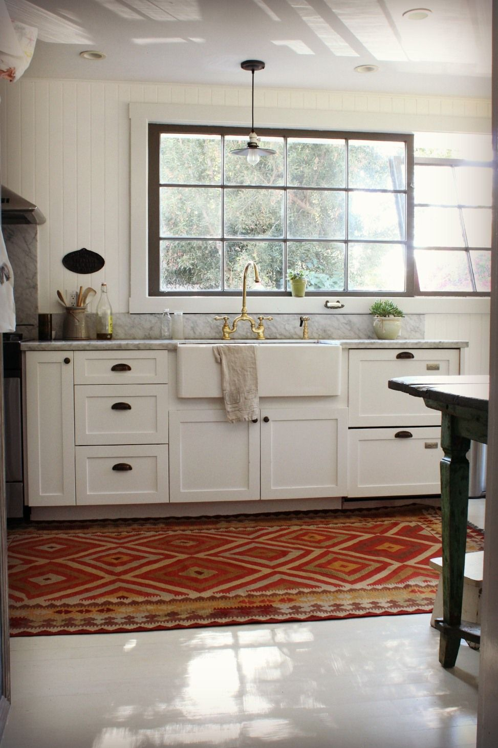 Country Kitchen Style With Red Oriental Rug Set In Front Of White