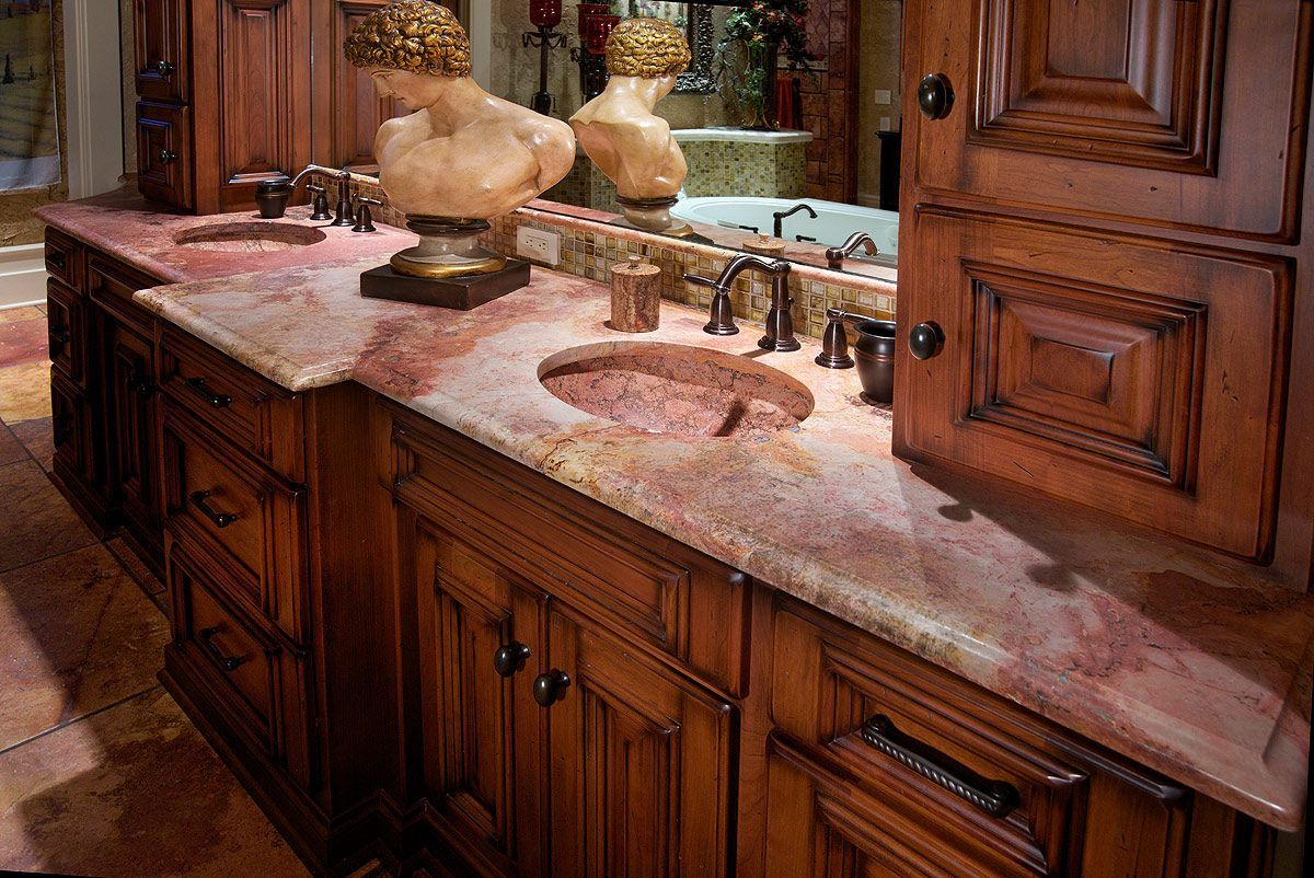 Custom cherry cabinetry with marble countertop and bowls #bowls #cabinetry #cherry #countertop #Custom #Marble
