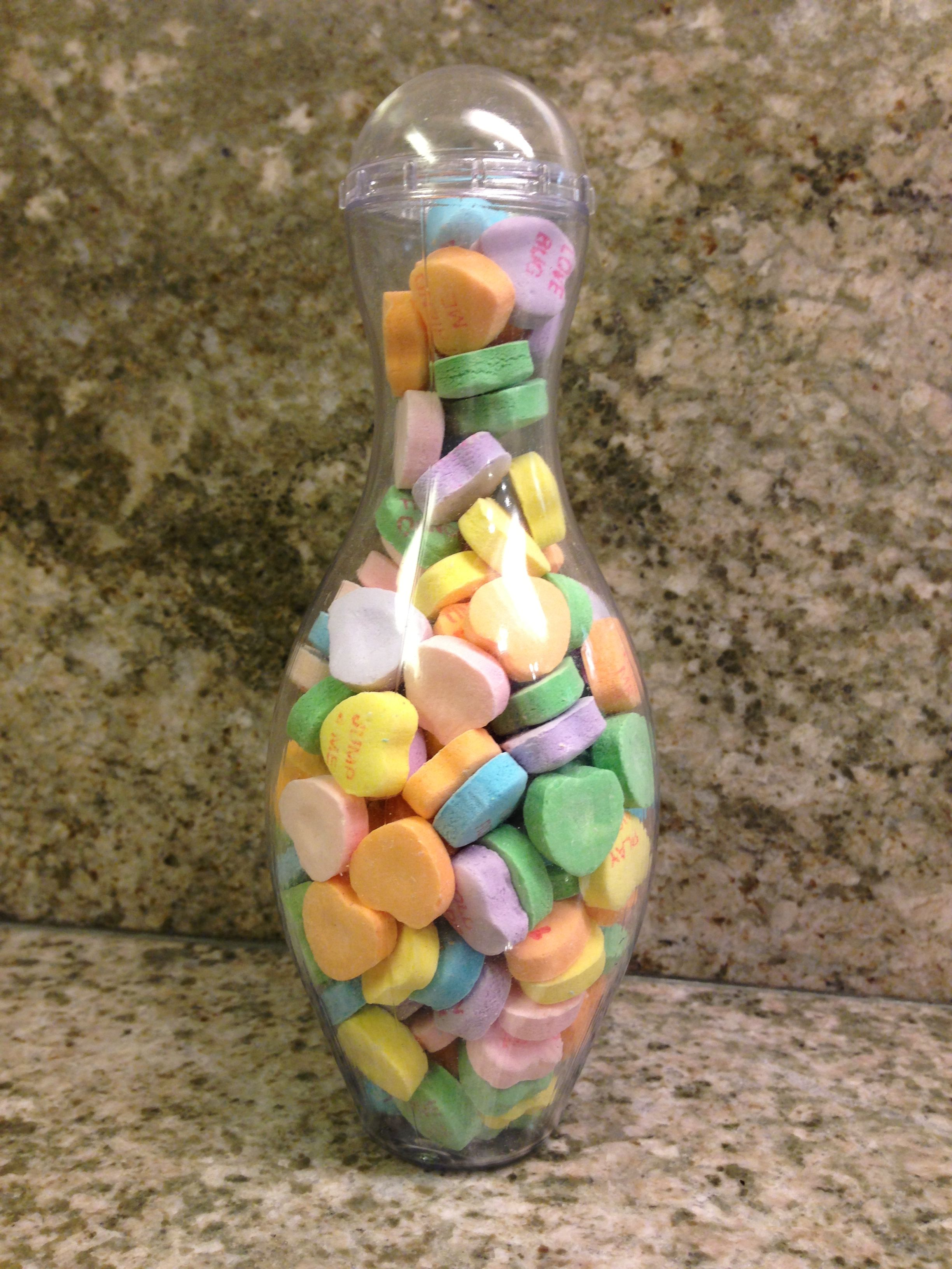 Mini Bowling Pin filled with conversation hearts. So many great ways to use our mini bowling pin containers! Great for Valentine's Day!