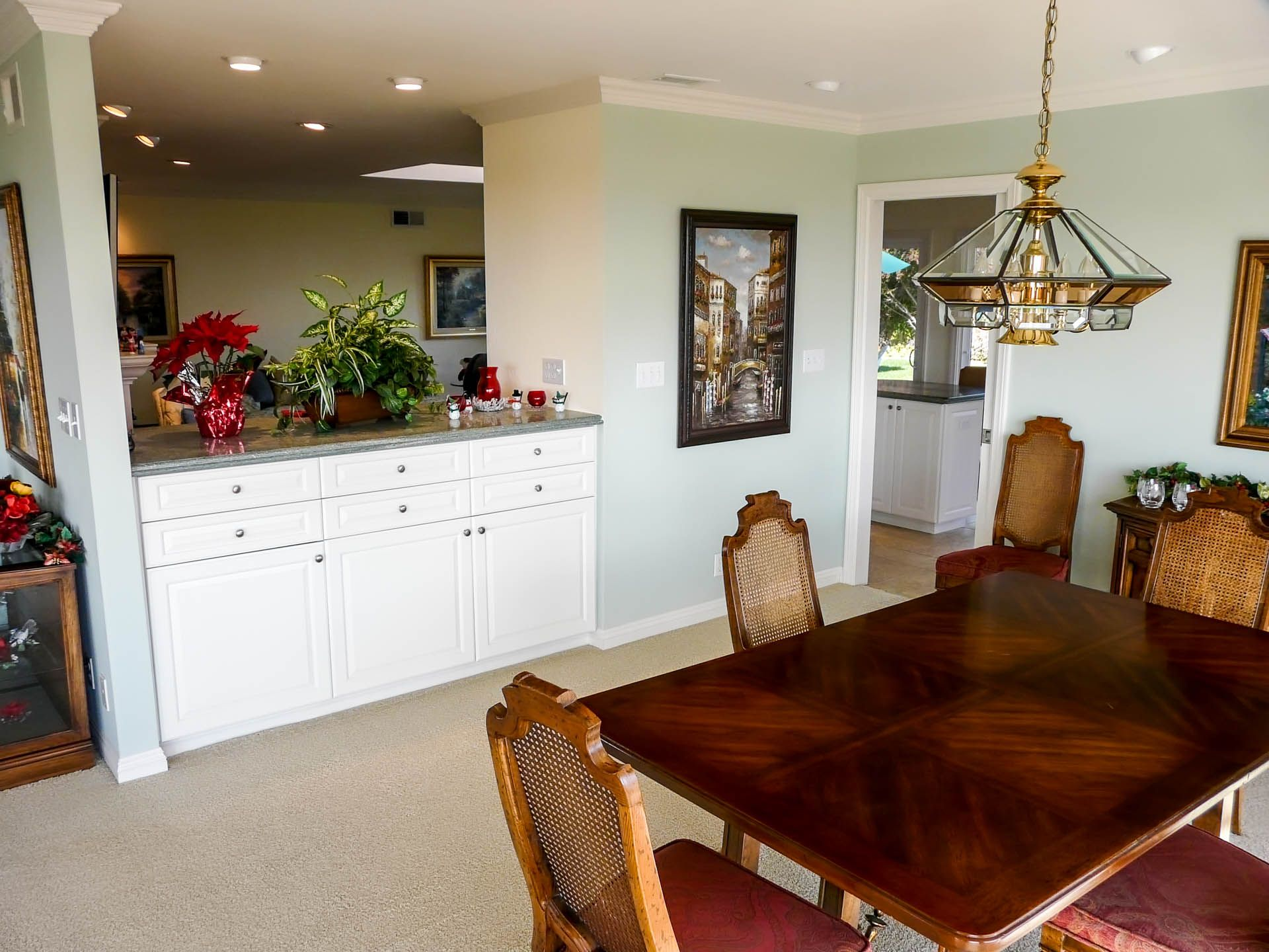 dining room with passthrough to family room and entrance to