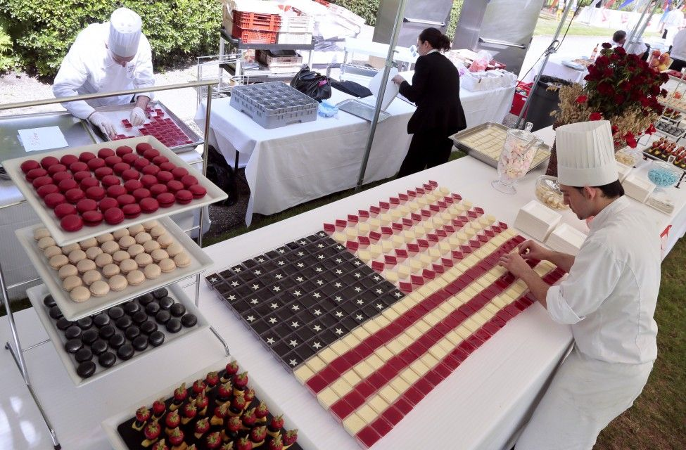Cooks prepare 'Stars and Stripes' desserts for a buffet before a ceremony for the July 4th Independence Day celebrations at the U.S. Embassy in Paris, France. (AFP)