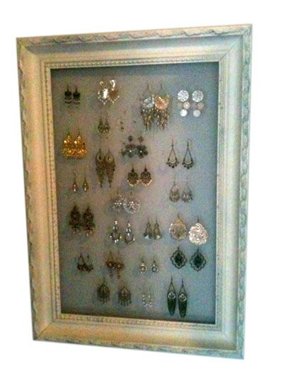 picture frame turned earring holder. just need to hammer a hanger on ...