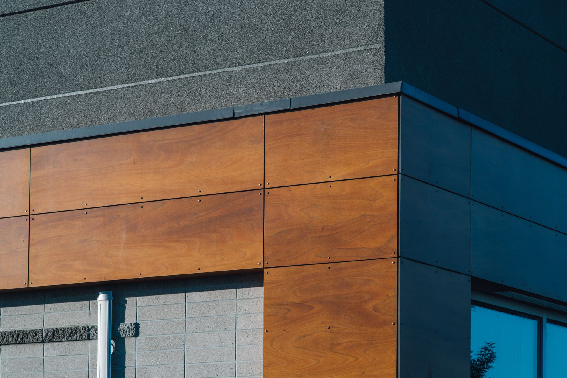 Wood composite panels / Phenolic Resin Panels, on the corner of a building.  | Architecture, Composite wood, Paneling