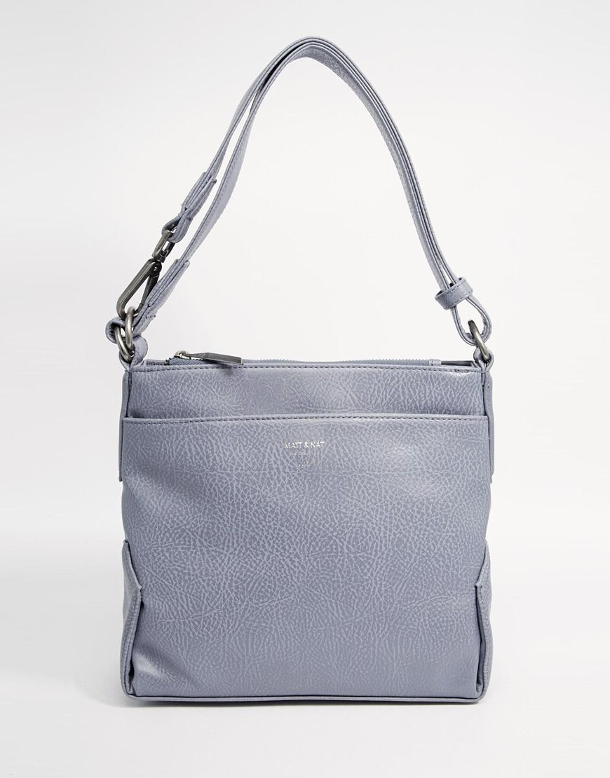 """Bag by Matt & Nat Smooth leather-look outer Compartment with press stud fastening Z ip top compartment External slip pocket Adjustable strap with secure clip detailing Wipe with a soft cloth 100% Polyvinylchloride H: 24cm/9"""" W: 27cm/11"""" D: 4cm/2"""""""