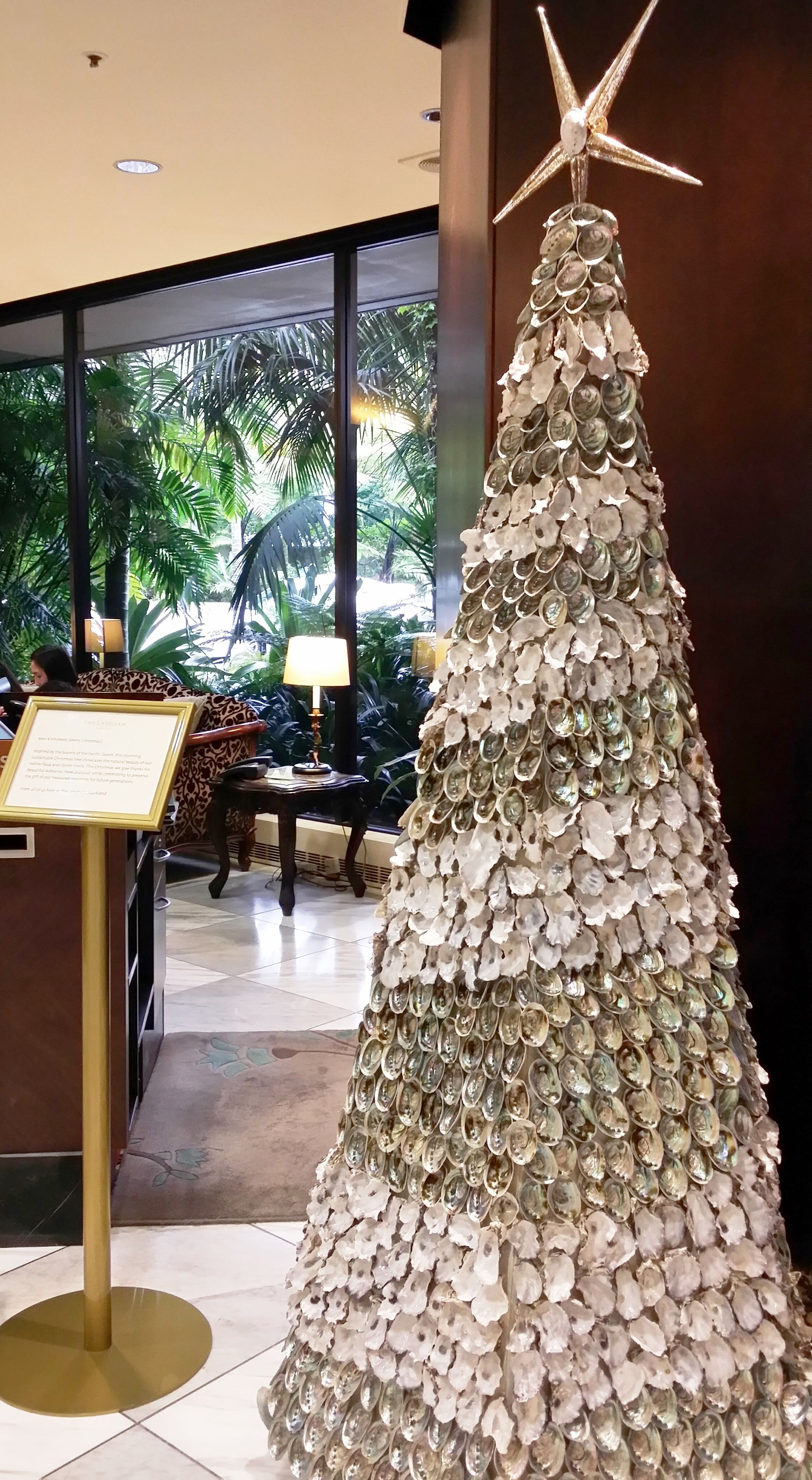 This Unique Sustainable Christmas Tree In Auckland Is Inspired By The Natural Beauty Of Nz Paua And Oyster Shell Sustainable Christmas Christmas Tree Christmas