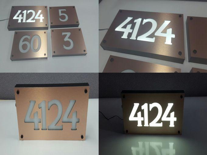 Brushed copper engraved front lit led address number sign
