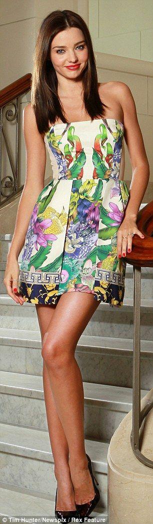Miranda Kerr in a tropical print dress.....