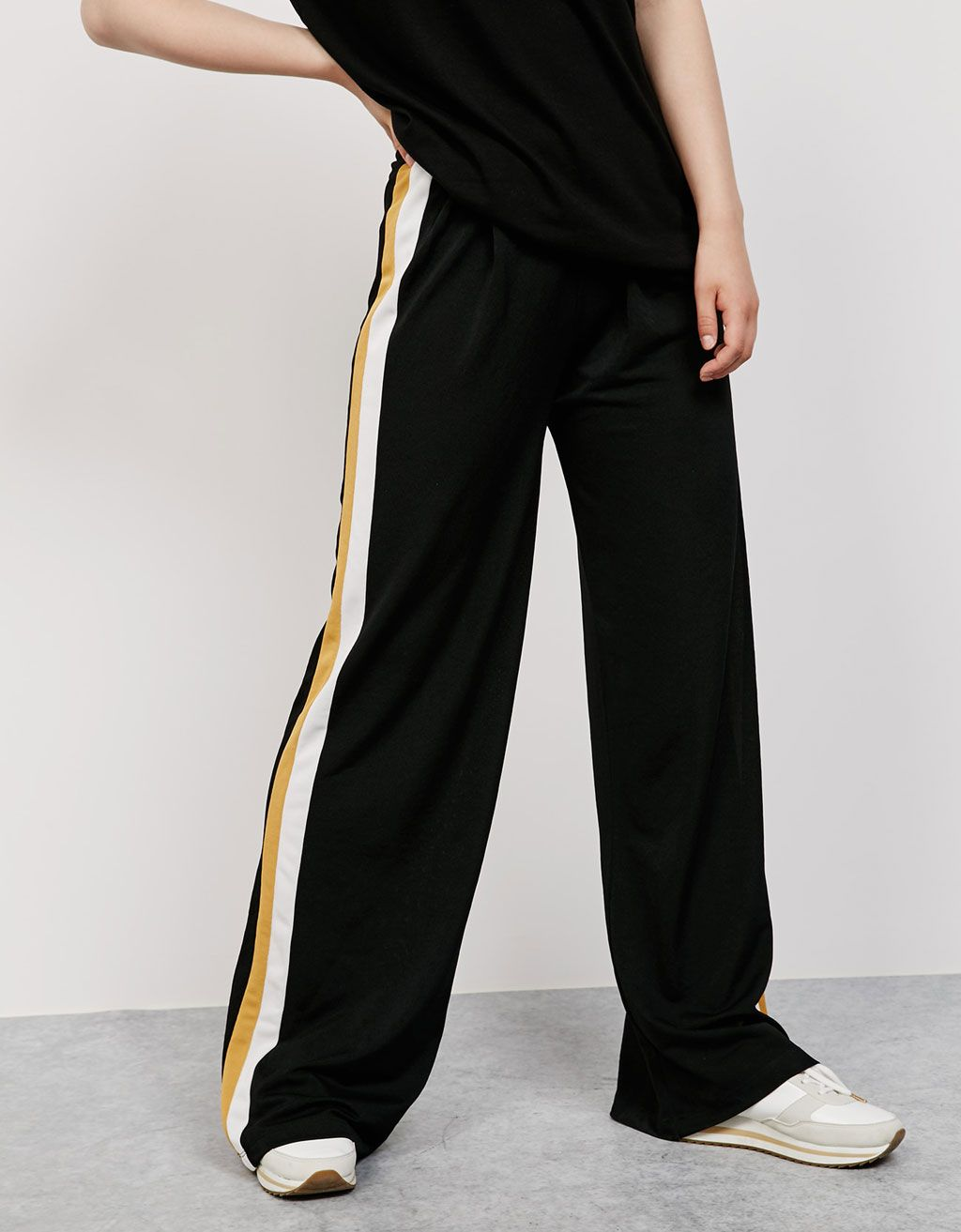 Wide trousers with side stripe. Discover this and many more items in  Bershka with new