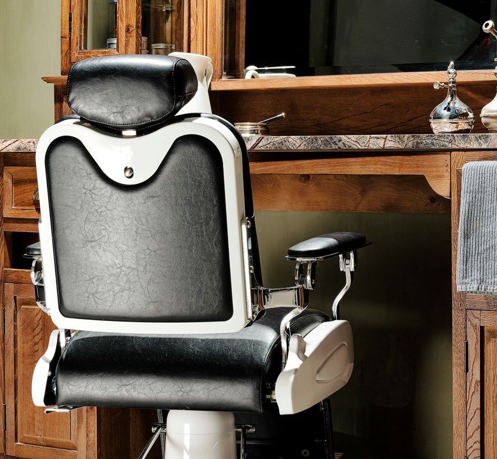 a black barber chair in front of our teak barber unit the rh pinterest com