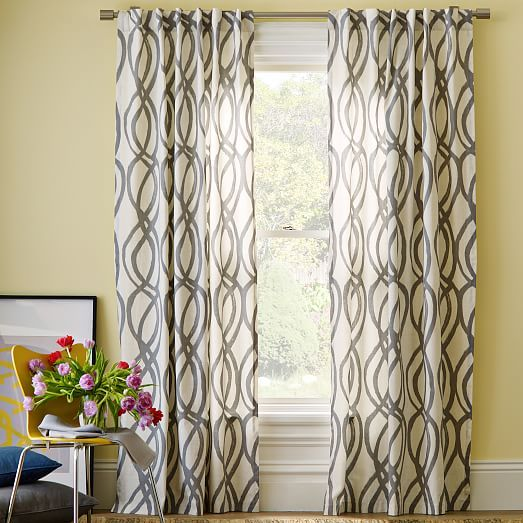 Cotton Canvas Scribble Lattice Curtains (Set of 2)  Feather Gray is part of Yellow Home Accessories West Elm - Curves ahead  Ribbonlike swirls cascade down the length of this Cotton Canvas Scribble Lattice Curtain, forming a loose, latticelike pattern and bringing subtle movement to a room  The neutral gray and ivory palette works well with other prints and patterns