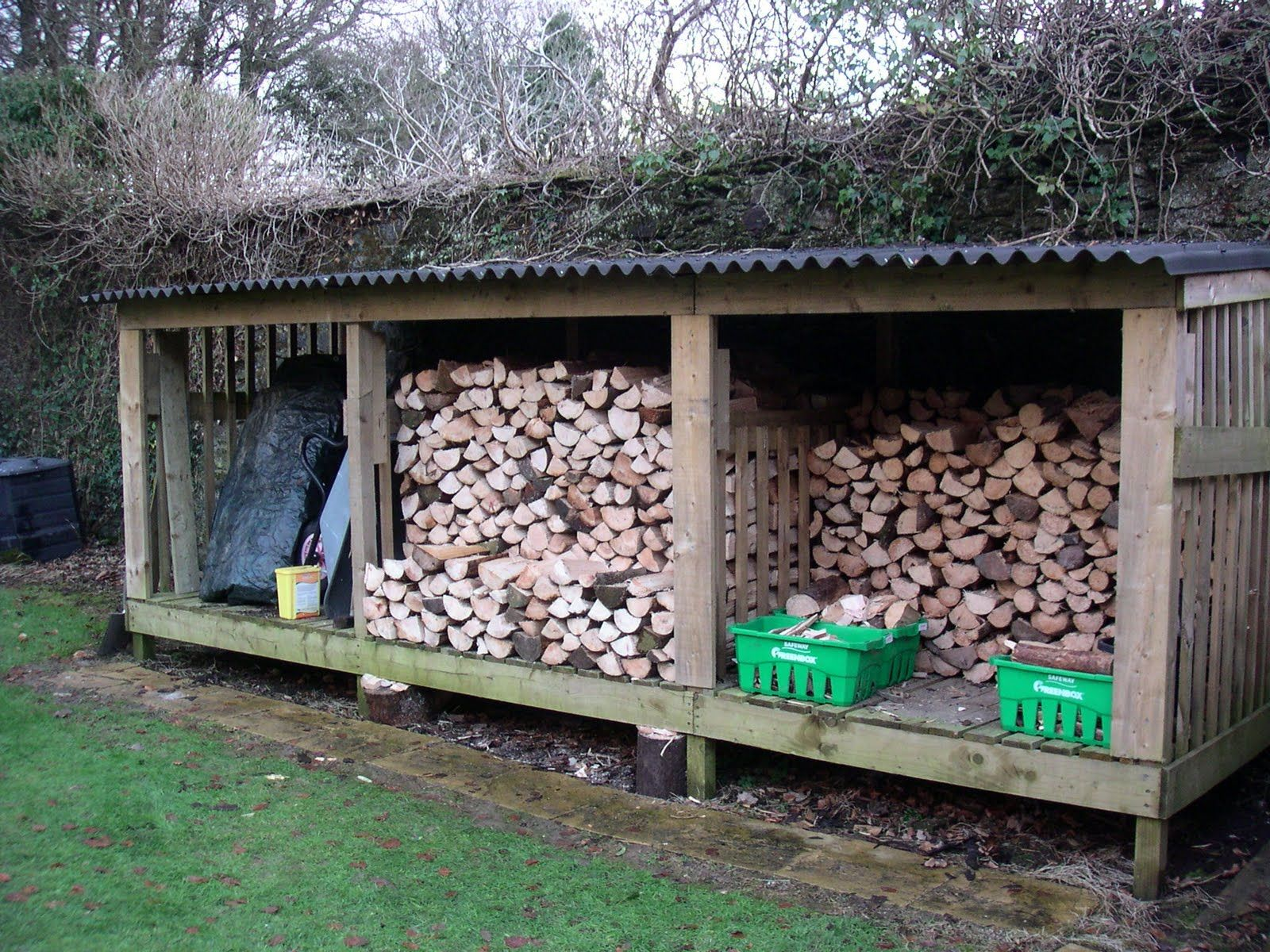 Homestead landscaping wood shed i hate looking at the for Cordwood shed