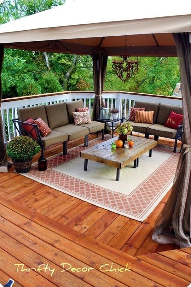 Deck Tip A Gazebo Creates Relaxing Outdoor Seating Area With Two Sofas Coffee Table And Candelabra From Thrifty Decor