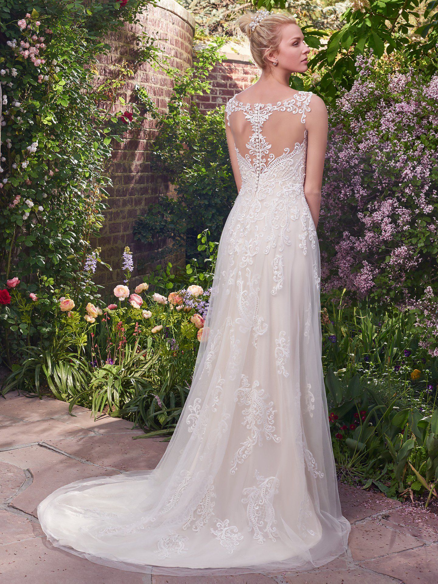 082d15da482 Illusion details accented in lace appliqués create beautiful back interest.  Finished with covered buttons over zipper closure. Alexis Wedding Dress ...