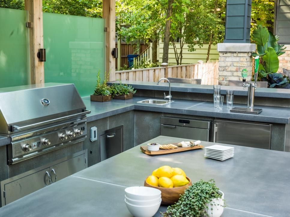 This Outdoor Kitchen Is Party Ready And Comes Complete With Stainless Steel Appliances A S Modern Outdoor Spaces Modern Outdoor Kitchen Outdoor Kitchen Design