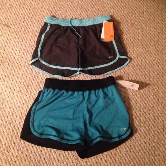 Blue/grey/black/turquoise running shorts !! 2 pairs. Both size small. From target. Top pair has built in spandex brief.  Bottom pair does not. Never worn! Champion Shorts