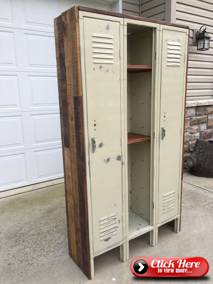 Repurposed Old lockers with wood from pallets. Thats a cool way for them to match the new office. #vintageindustrialfurniture