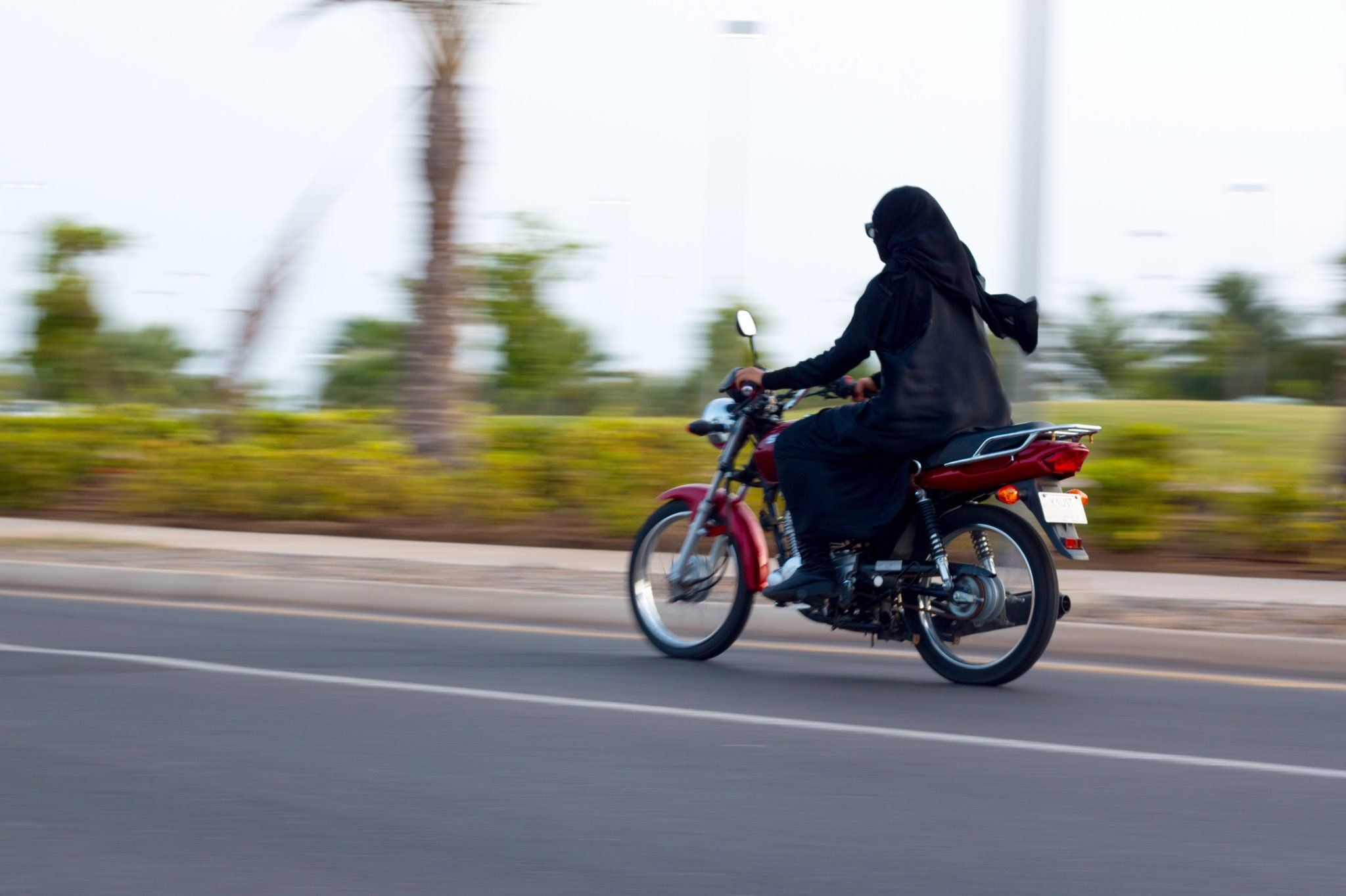 Image result for woman in hijab riding motorcycle on highway