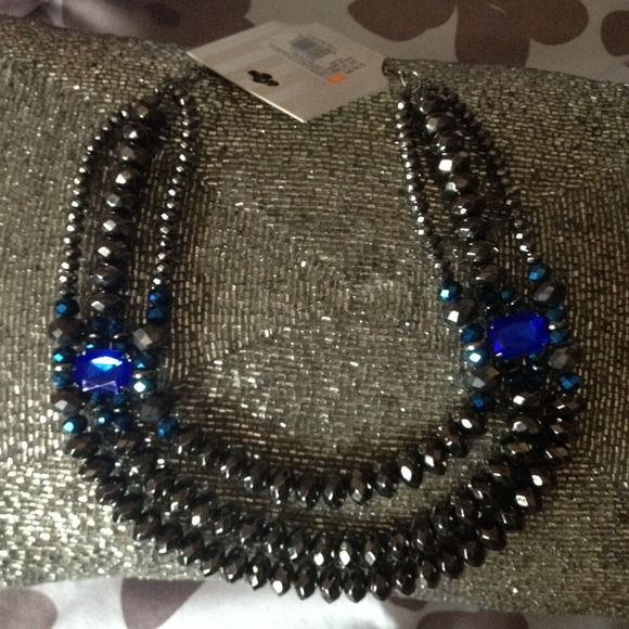 3 strand fashion statement necklace Dazzling dark grey 3 strand necklace with blue stones. A great piece for evening wear! No trades. If you would like to make an offer please use the offer button. And remember I offer a bundle discount. Happy Poshing! Target Jewelry Necklaces