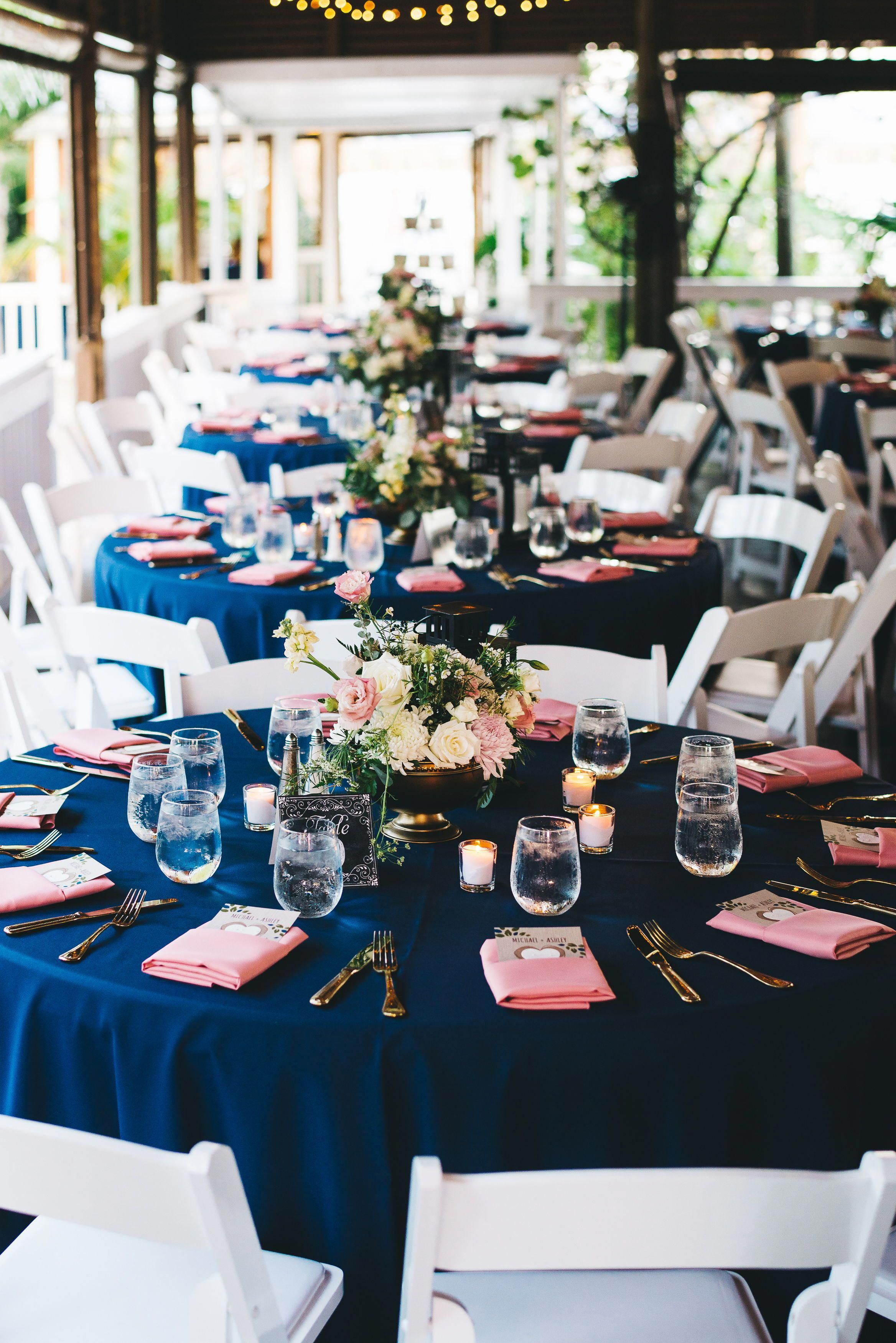 Blush and navy round table wedding setting