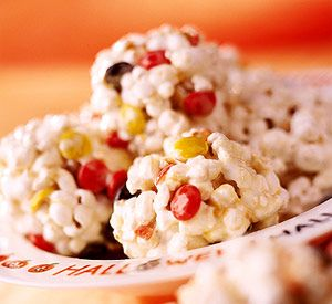 Popcorn and Candy Balls Recipe ~     Save popping time by using bags of popcorn to make these party treats.