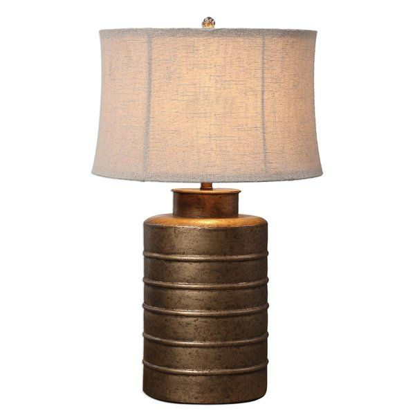Ribbed metal finished in a heavily antiqued gold leaf. The round semi bell shade is a light beige linen fabric with natural slubbing. Slight dimples in the metal base are to be expected.