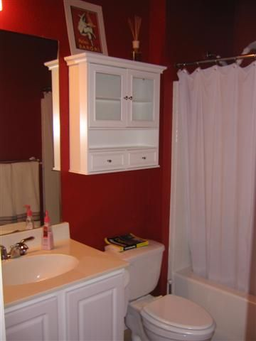 our bathroom is red, a cabinet would be nice to put in there, if