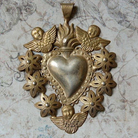 Vintage silver ex voto sacred heart sacred heart metals and gold metal heart pendant surrounded by gold cherubs aloadofball Images