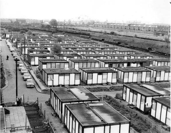 Rows of WWII era pre-fabs at Stoneyard Lane, Poplar, East London. Some are now listed structures