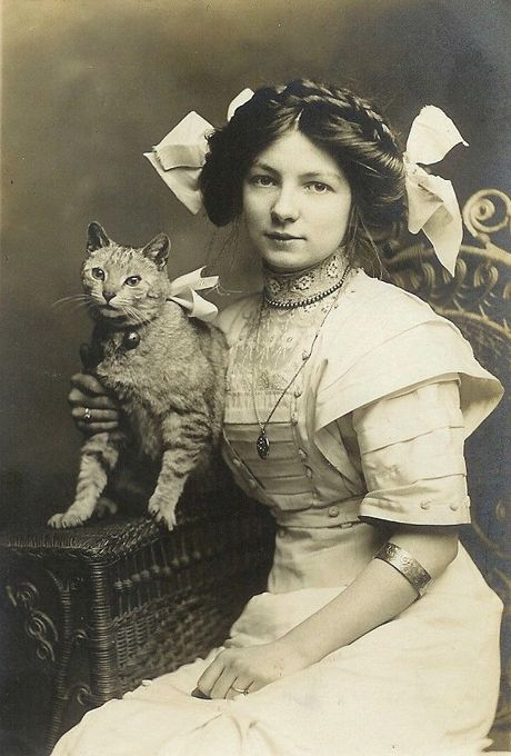 awwww.Now thats pure style. She most likely was very uncomfortable inside(tight garments abound)but she looks happy enough.I wonder who she was..the cat is good to see.I think I have one of his descendants.