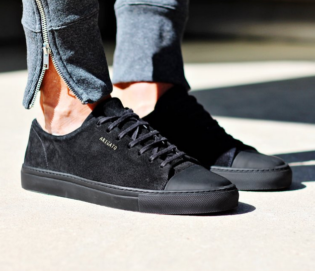 Axel Arigato all black sneaker with a classic design