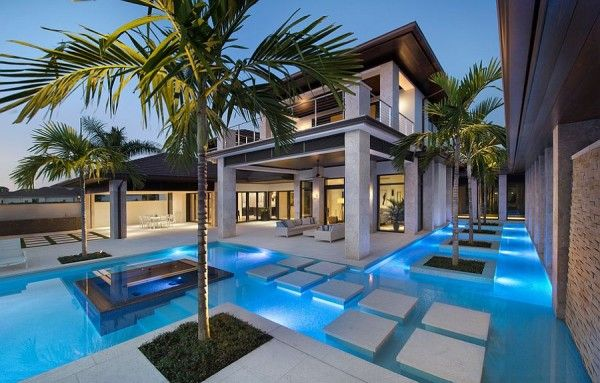 Stunning Pool With Precast Concrete Pool Deck And Stepping Stones   Decoist