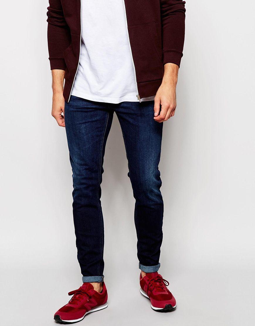 Jeans von Diesel 11,5 Unzen schwerer Stretch-Denim dunkle Waschung niedrige Bundhöhe geknöpfter Schlitz supereng - nah am Körper geschnitten Maschinenwäsche 92% Baumwolle, 6% Polyester, 2% Elastan unser Model trägt Größe 81 cm/32 Zoll und ist 185,5 cm/6 Fuß 1 Zoll groß