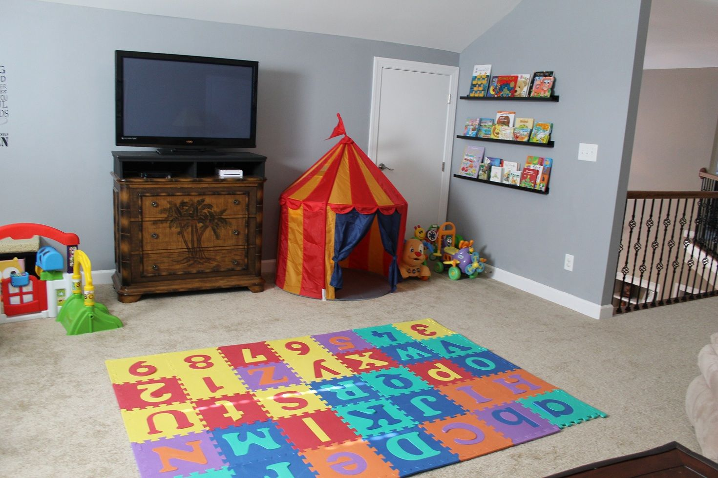Baby Playroom Ideas With Cabinet And Tv Also Rack As Well Blue Wall