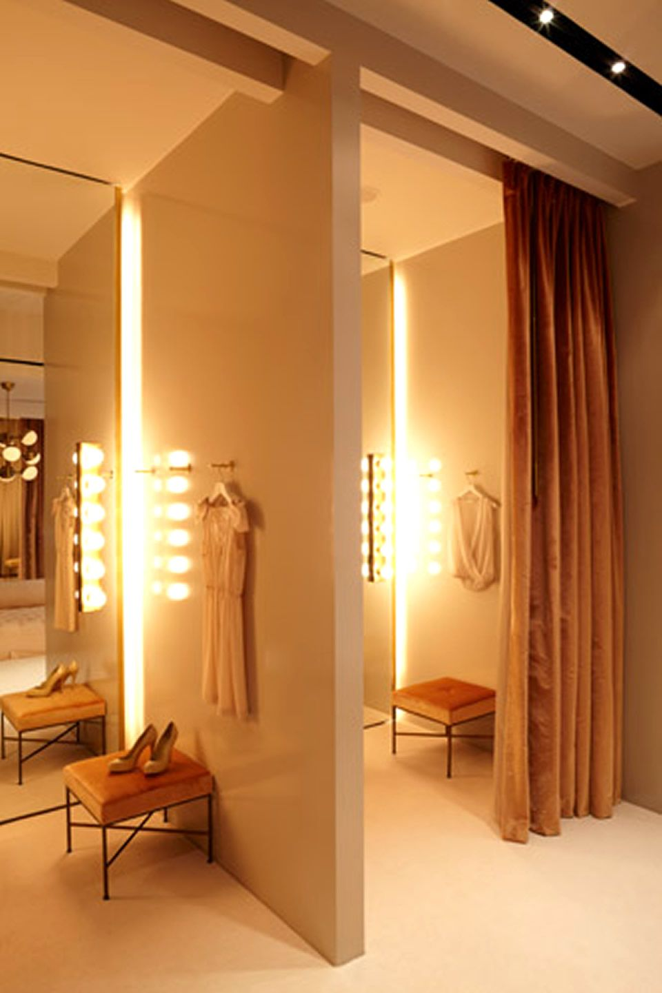 Dressing Room of Fashion Retail Store Interior Design. Makeup lights next to the mirror  Dressing Room of Fashion Retail