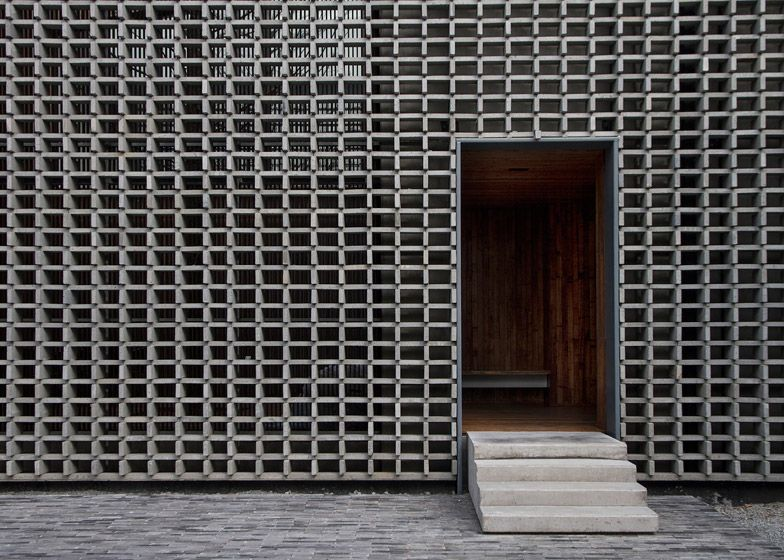 Bricks give a perforated facade to mountain building by li for Perforated brick wall